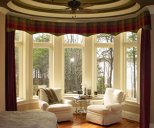 room with bay window, drapes, curtains